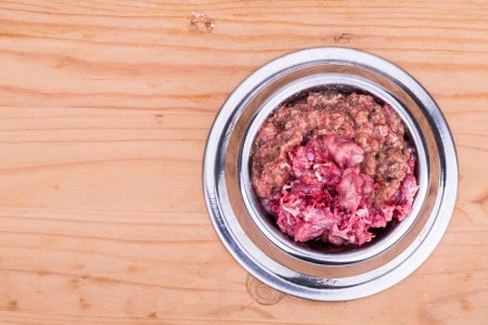 Fresh and nutritious minced raw meat dog food in bowl