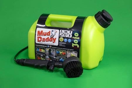 mud daddy portable washing device on green background