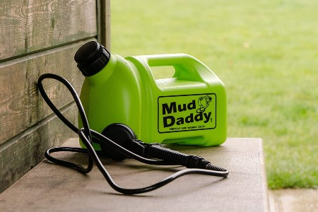 mud daddy portable washing device on table